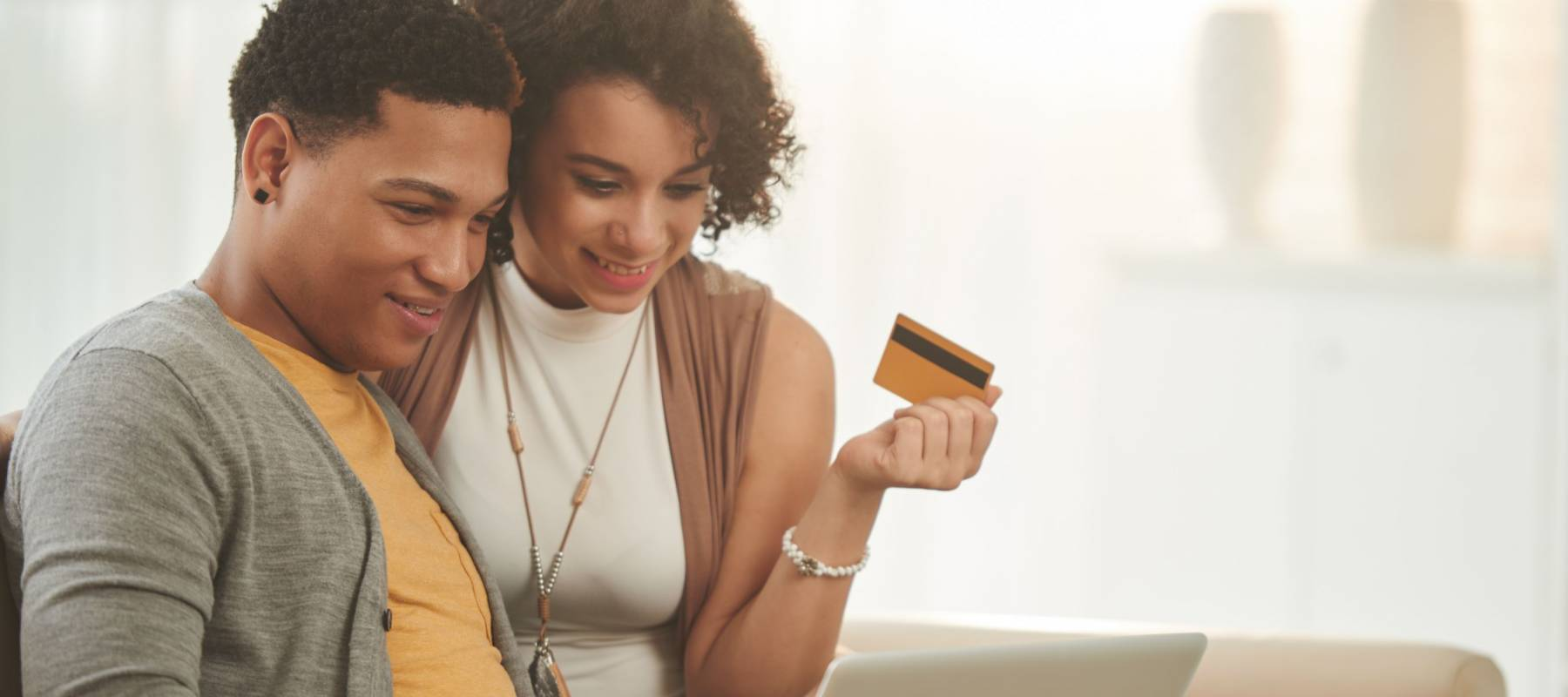 Latin-American couple checking their credit score online