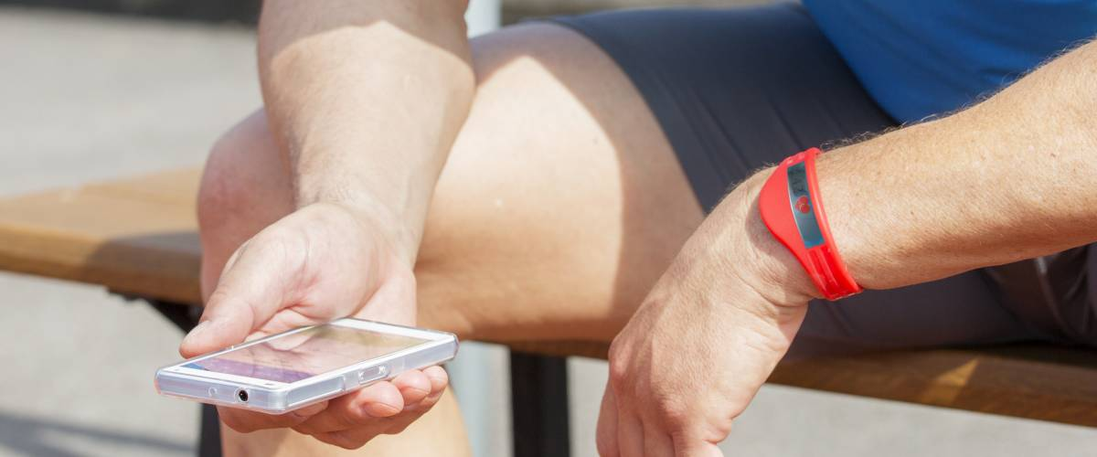 Man checking the fitness app on his smartphone