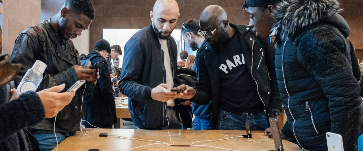 Customers admiring the iPhone X at an Apple store in France