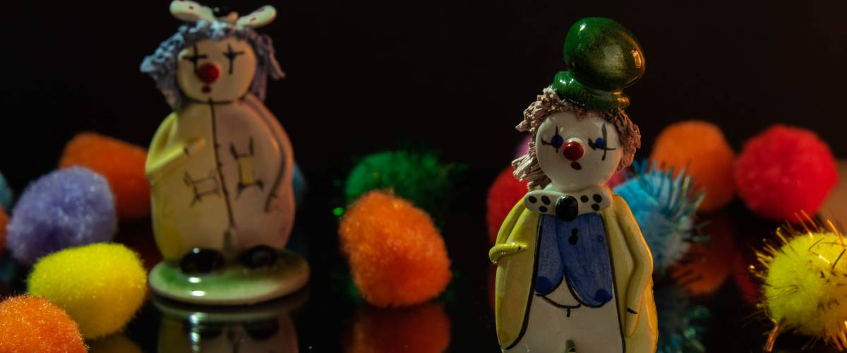 Clown figurines with colorful pompoms