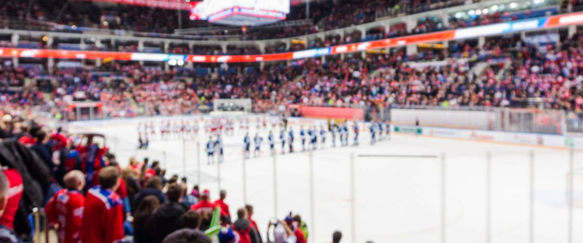 Defocused and blur background of the sport arena with ice hockey, olympic games
