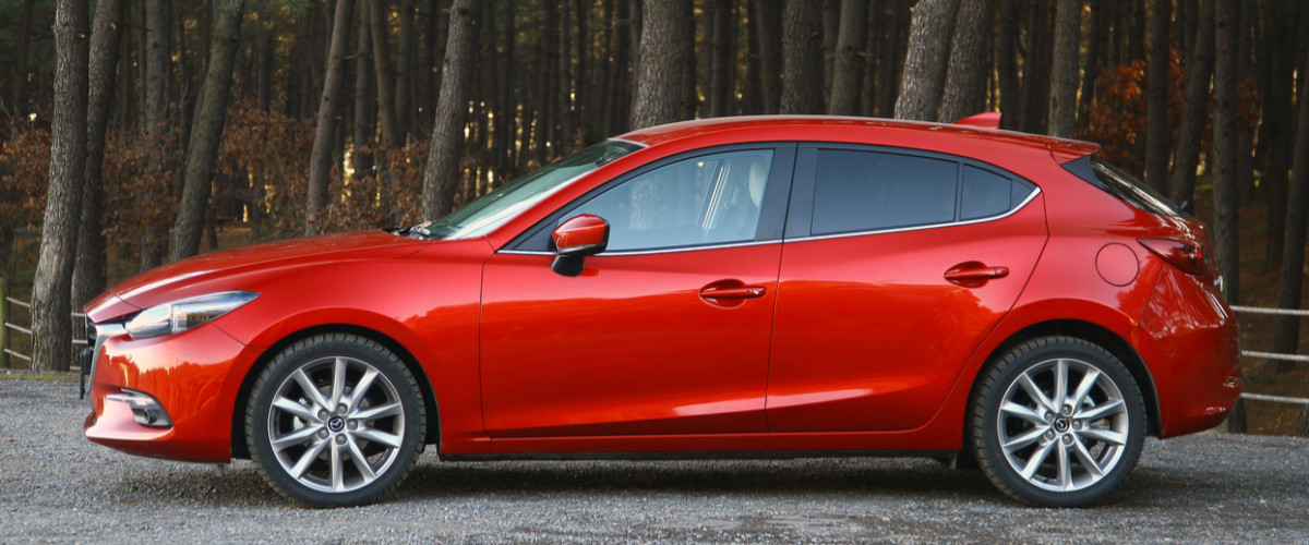 New red Mazda 3 hatchback car April, 2017