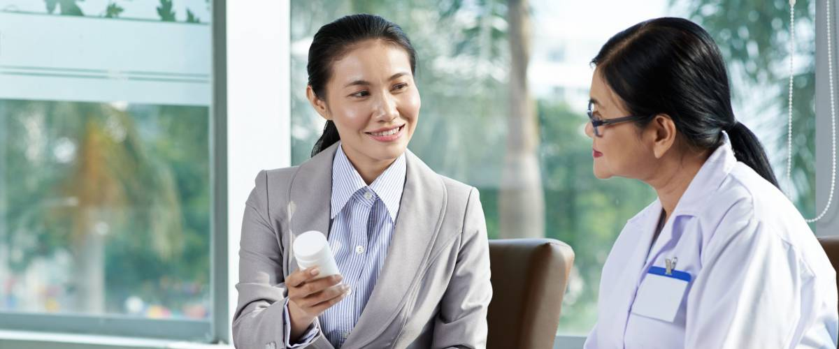 Sales woman presenting new product to pharmacist