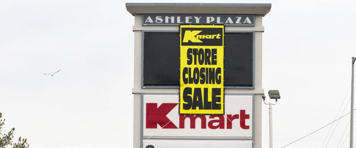 KMart store in Goldsboro, North Carolina, slated to close in March 2017. Maintenance truck in front of Ashley Plaza sign where banner advertising the KMart liquidation sale was just hung.