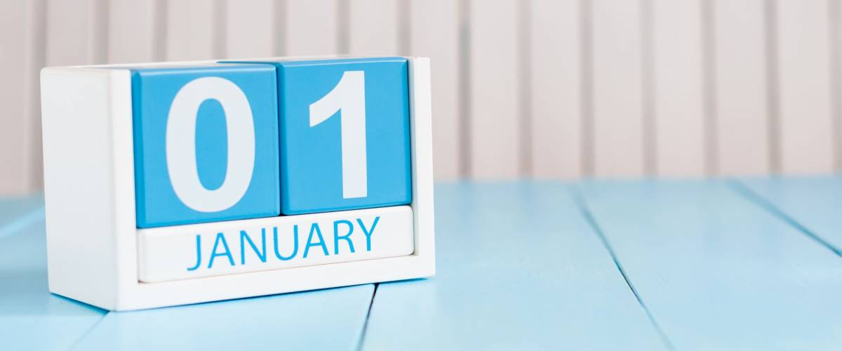 January 1st. Day 1 of month, calendar on wooden background. Winter time, New year concept. Empty space for text