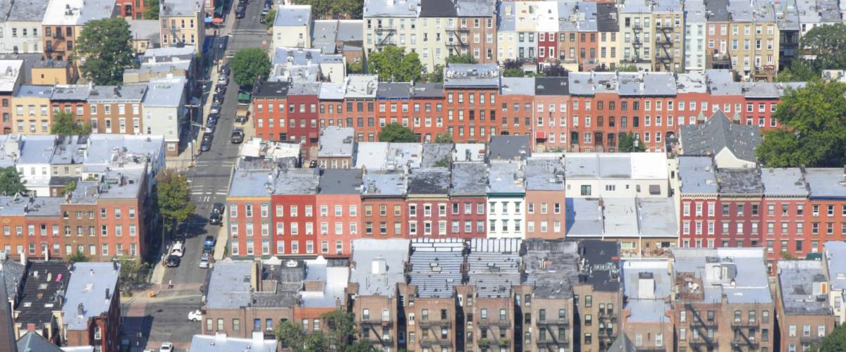 Aerial showing patchwork of homes and buildings in Hoboken, New Jersey.
