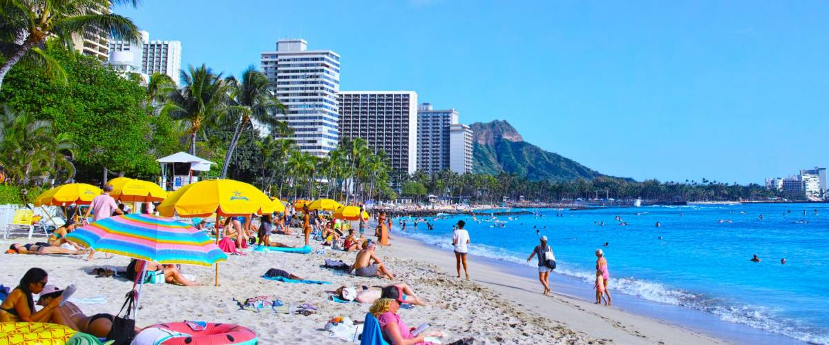Honolulu, HI, USA - Mar 18, 2017: Tourists who sunbathe and swim in Waikiki Beach, Hawaii. Hawaii will be a perfect day for swimming in warm, sunny days throughout the year.