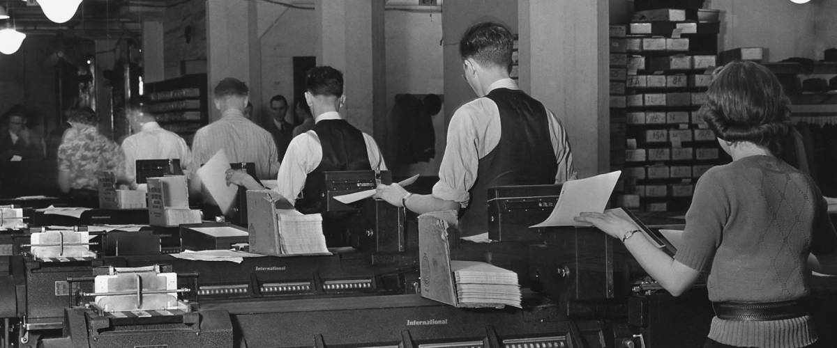 Social Security Administration clerks seated at massive tabulating machines in the Social Security system. Ca. 1940.