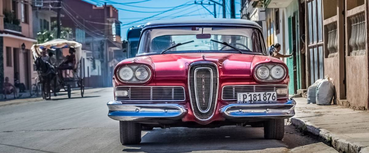 Santa Clara, Cuba - September 11, 2016: HDR - American red Ford Edsel classic car with white roof parked on the side street in Santa Clara Cuba - Serie Cuba Reportage