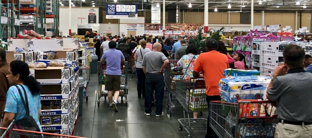 ELKRIDGE, MD, USA - APRIL 30, 2017: Costco Wholesale showing a large influx of shoppers, creating a checkout line that stretches halfway back though the store.