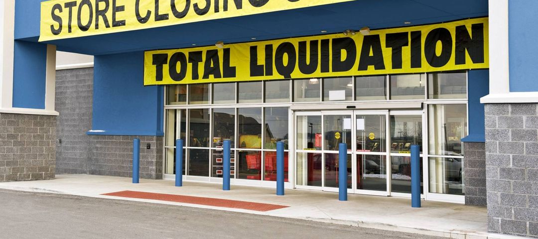 Angled Shot Of Retail Store Closing Sale/ Total Liquidation