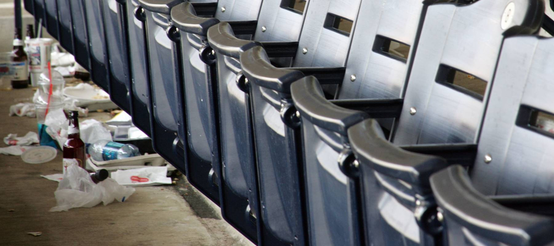 ballpark seating with trash