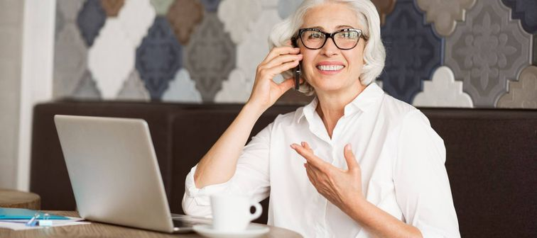 Cheerful senior woman talking on cell phone