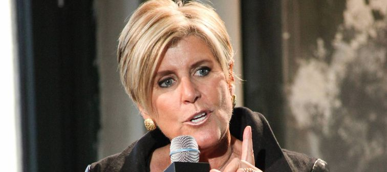 Suze Orman, holding microphone and speaking at event in New York in 2014