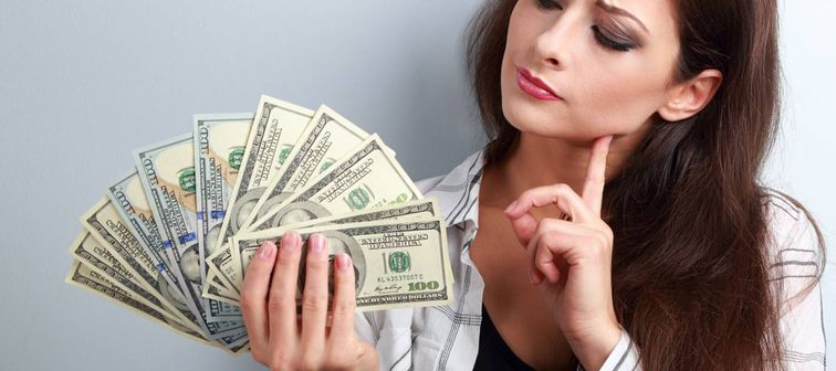 Serious concentrated thinking business lady thinking where invest money and how to earning more dollars