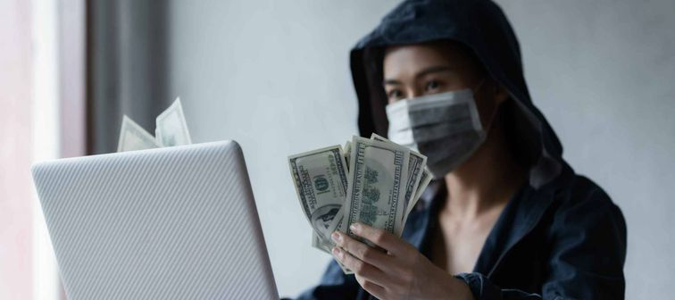Hacker asia women stealing data success from online computer systems by using laptop. concept of business malware and hacker