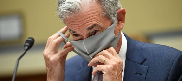 Federal Reserve Chair Jerome H. Powell removes his face mask at a U.S. House hearing on Sept. 23, 2020.