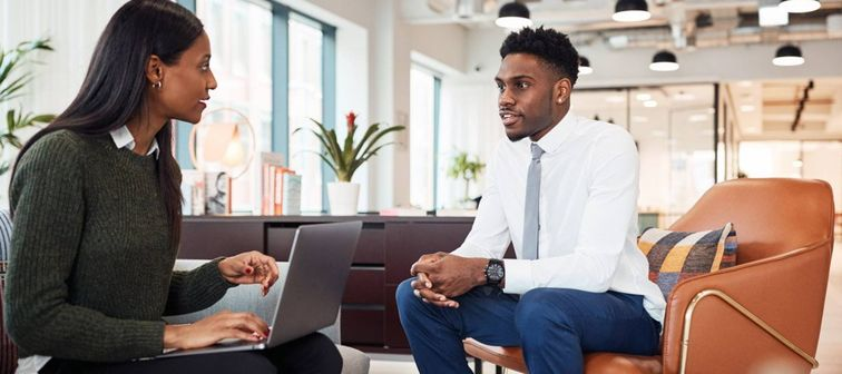 Female African-American hiring manager interviews African-American job candidate