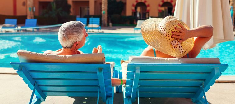 Retired couple by the pool