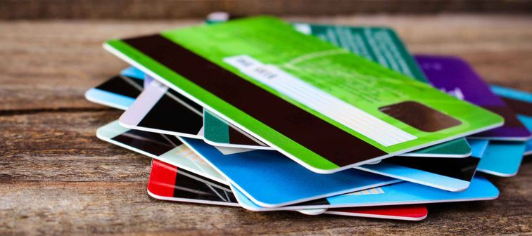 Credit card on wooden background.