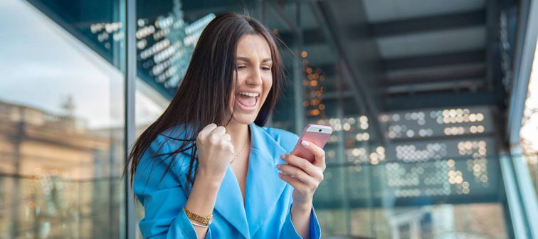 Excited woman checking her phone