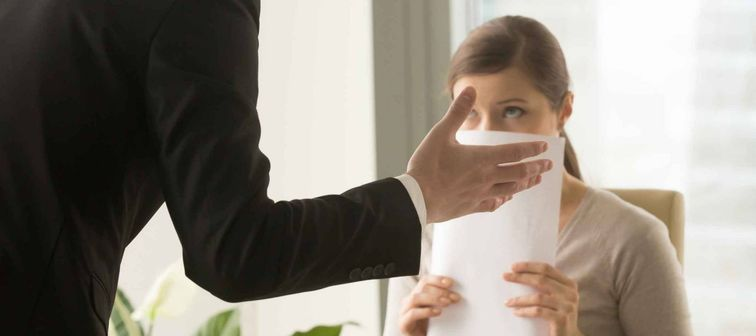 Angry boss reprimanding employee afraid to be fired