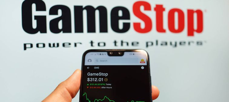 ameStop Corp stock index is seen on a smartphone. GameStop's stock soars as small traders from a Reddit group team up against big institutions.