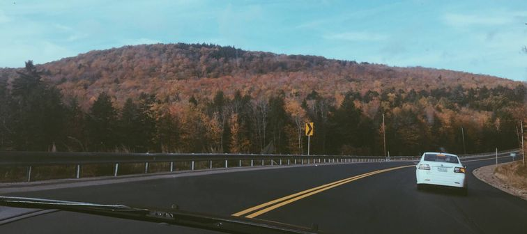 Car driving on highway in Maine
