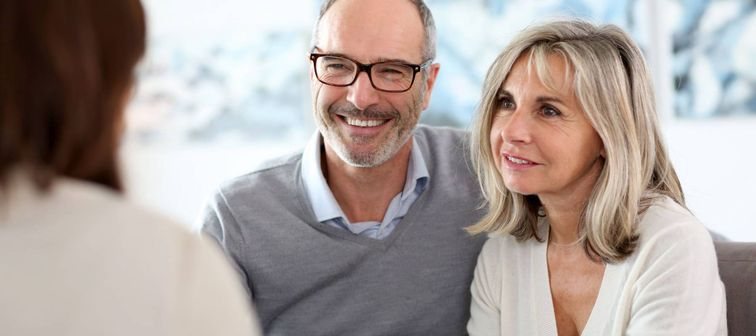 Couple meeting financial adviser to enquire about senior checking accounts