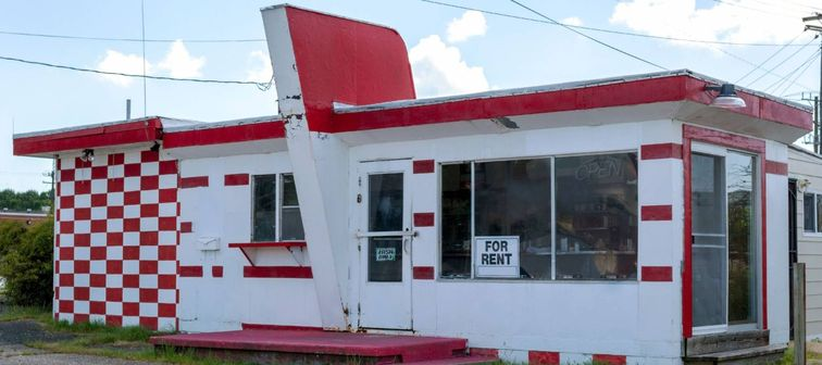 Rundown abandoned red and white roadside diner.