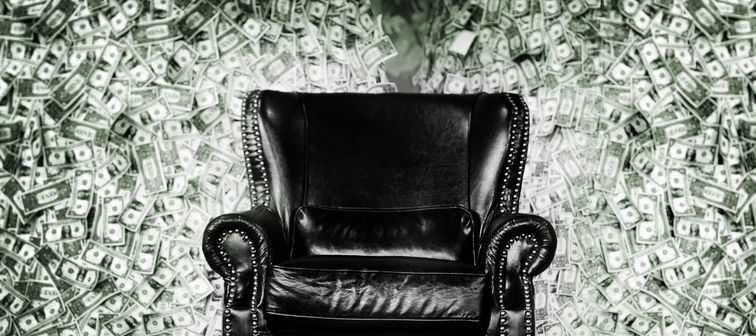 millionaire rich leather luxury seat on money banknote mountain background for rich man or money game concept