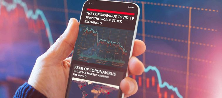 The coronavirus sinks the global stock exchanges. Smartphone app showing the collapse of the stock market due to the global Coronavirus virus crisis.