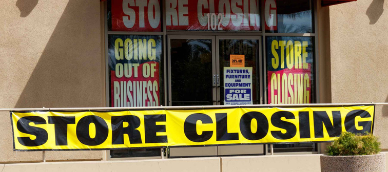 Store Closing and Going out of Business signs displayed at a soon to be closed store
