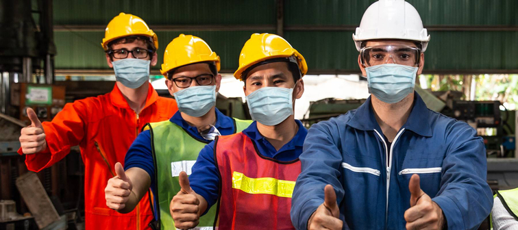 Workers wearing COVID-19 face masks