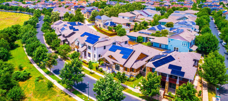 Solar panel rooftops covering a sustainable community in east Austin Texas 2019 aerial drone view of suburb with renewable energy and solar energy colorful bright future living