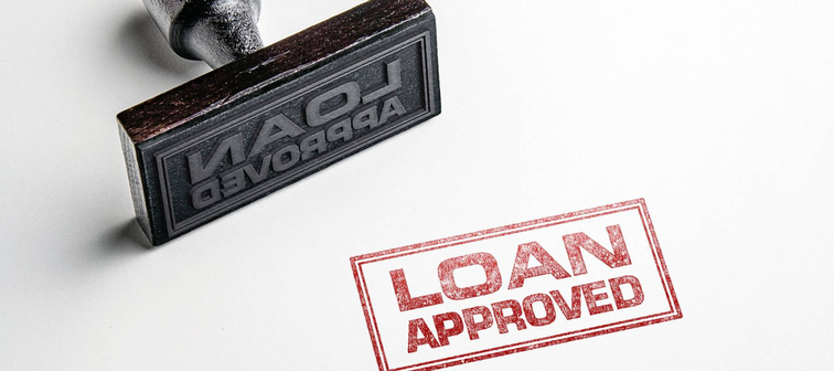 Rubber stamping that says 'Loan Approved'.