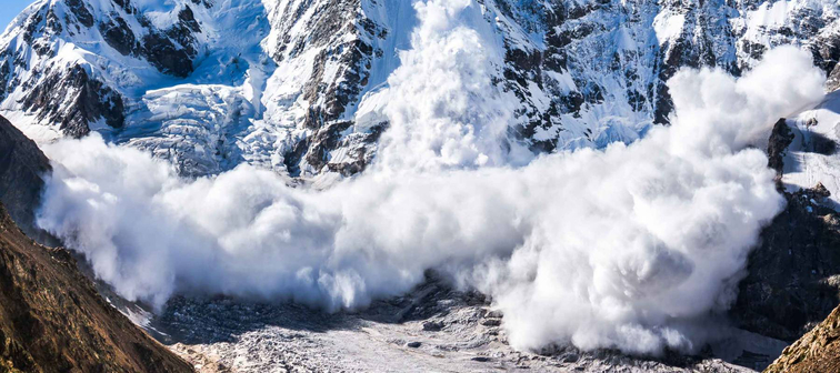 Power of nature. Real huge avalanche comes from a big mountain, Shkhara, 5.193 m, Caucasus, Kabardino-Balkaria, Bezengi region, Russia