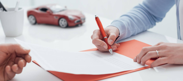 Woman signing car loan
