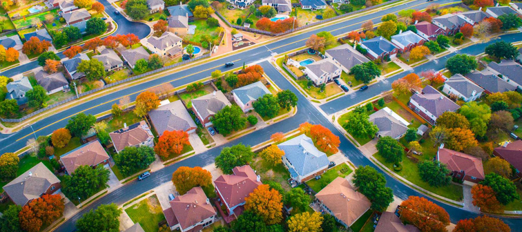 colorful foliage changes colors aerial drone view above Suburb neighborhood with fall colors charging leaves and gorgeous colorful landscape above houses and homes