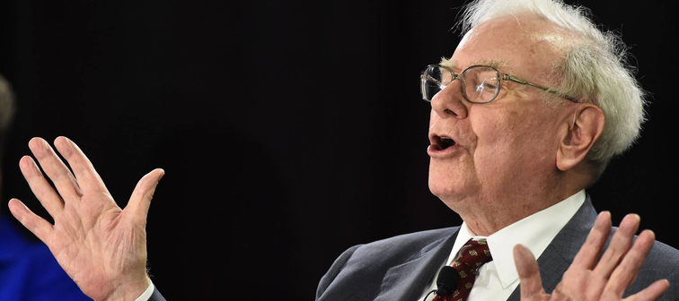 Warren Buffett speaks on stage
