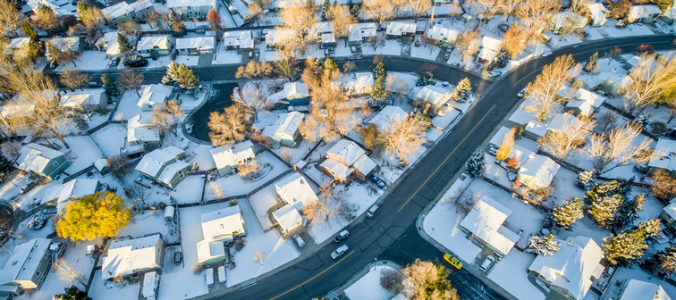 Arial shot of neighborhood in the winter with snow