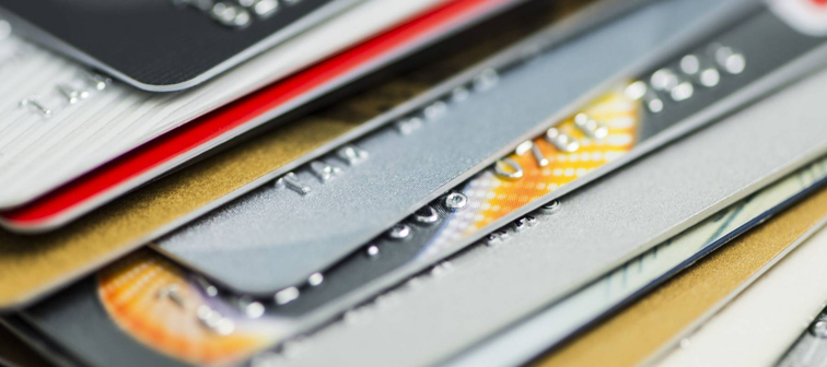Stack of multicolored credit cards close-up