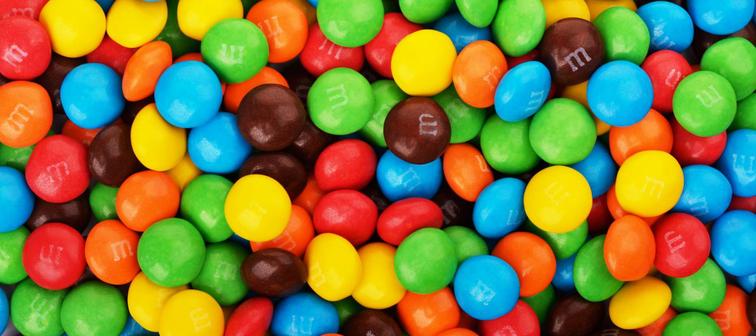 SAMARA, Russian Federation - April 29, 2017: M&M's candies. M&M's produced by Mars, Incorporated. Close up of a pile of colorful chocolate coated candy, chocolate pattern, candies background