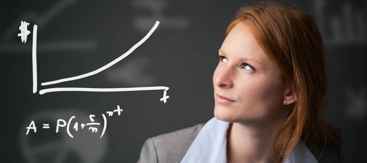 Young redheaded businesswoman contemplates a compound interest chart.