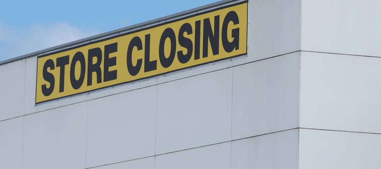 Store Closing black on yellow letters on a white cladded industrial building, Melbourne 2016