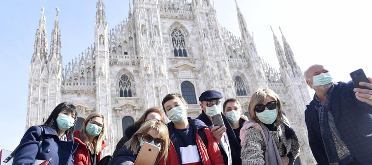 Tourists and Milanese people walk in the center with the mask to avoid a possible infection in Lombardy