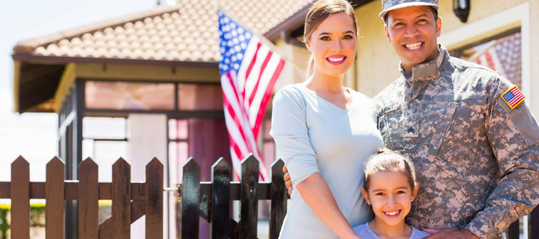 happy american soldier reunited with family outside their home