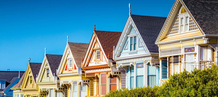 Classic postcard view of famous Painted Ladies, a row of colorful Victorian houses in San Francisco